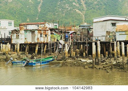 Exterior of the Tai O fishermen village with stilt houses and motorboats in Hong Kong, China.