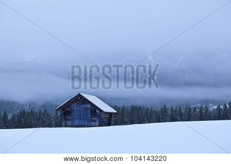 Old Wooden Hut On Snow In Alps
