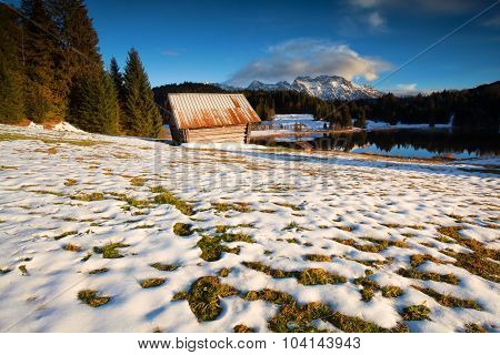 Old Wooden Hut On Snow Alpine Meadow