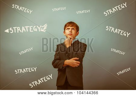 Teenage boy thinking businessman thinking idea inscription strat