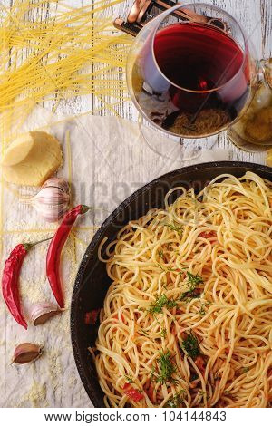 Spaghetti Pasta In Airon Frying Pan With Garlic, Tomatoes And Spices