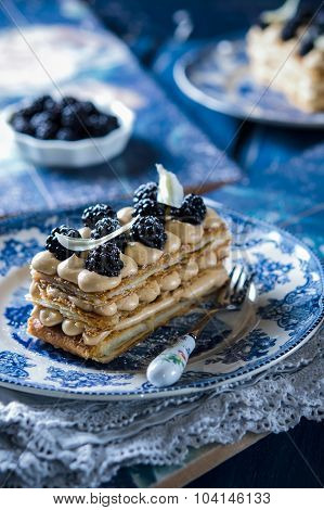 Millefeuille, french pastry with custard and blackberry
