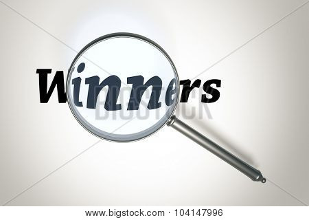 An image of a magnifying glass and the word winners