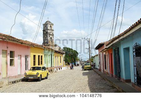 Street in Trinidad with Saint Anne church (Cuba)