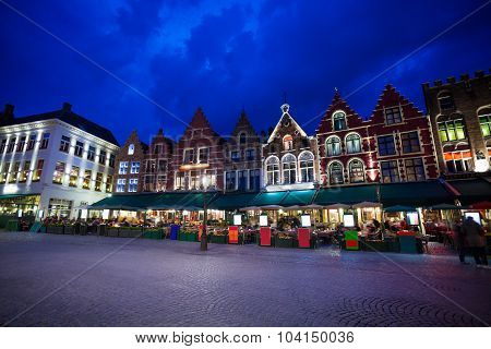 Grote Markt square with market at night in Bruges