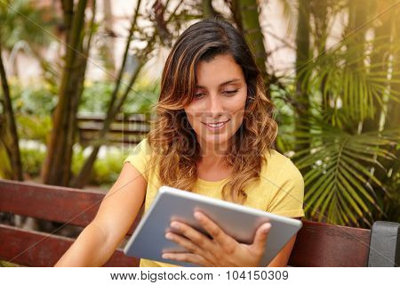Smiling Lady Using Tablet Ahead Palms Park