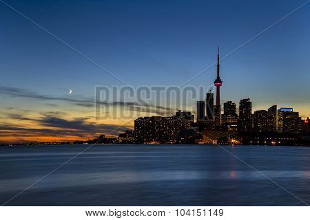 The Toronto skyline at twilight, lake Ontario.