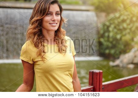 Young Lady Smiling While Standing Near Park Lake