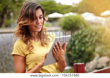 Young Woman Browsing Internet Near Park Waterfall