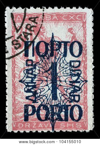 YUGOSLAVIA - CIRCA 1919: A stamp printed in Yugoslavia shows a man breaks the circuit, a symbol of freedom, circa 1919