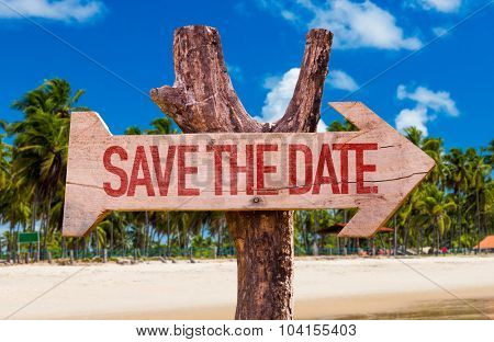 Save the Date arrow with beach background