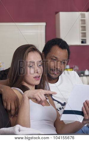 Interracial couple reading together