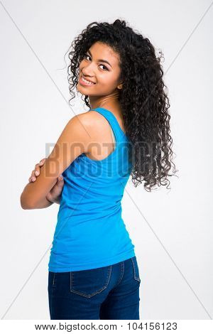 Portrait of a happy afro american woman looking back at camera isolated on a white background