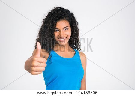 Portrait of a happy african woman showing thumb up isolated on a white background