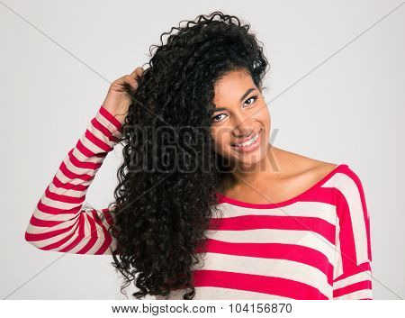 Portrait of a young cheerful afro american woman looking at camera isolated on a white background