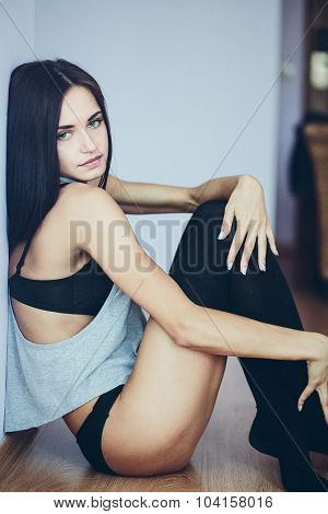 beautiful young girl posing sitting on the floor
