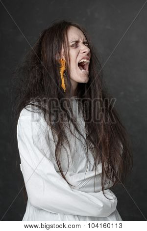 Crazy Woman Screaming In A Straitjacket.