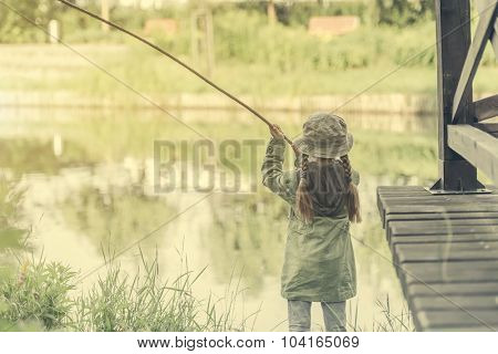 little fisher girl and a river background