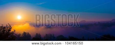 Autumn fog at misty fields, sunrise or sunset