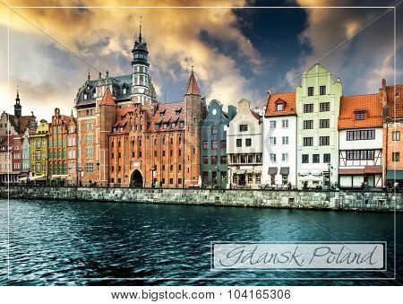 postcard with Cityscape on the Vistula River in historic city of Gdansk at sunset  in Poland