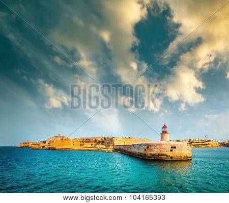 Lighthouse in Valletta from sea