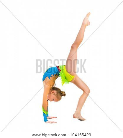 tittle gymnast doing stretching exercise isolated on white background