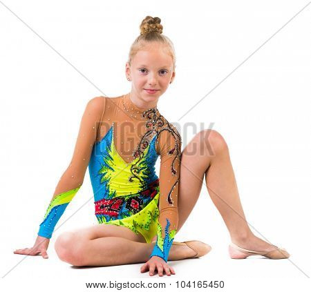 little gymnast in costume sitting on the floor isolated on white background