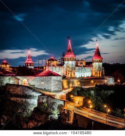 nighttime view on Kamenetz-Podolsky fortress in lights