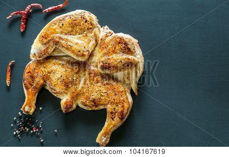 Grilled Chicken With Ingredients On The Dark Wooden Background