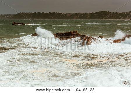 big waves crashing on rocks Bretagne France