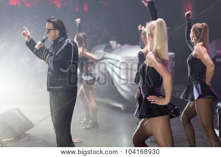 MOSCOW, RUSSIA - NOVEMBER 15, 2014: Roman Zhukov performs on stage at a party Diskach 90th in a club Space Moscow. Roman Zhukov - Soviet, Russian musician, singer and composer