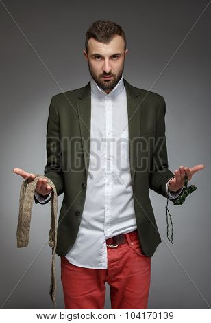 Young Man In A Green Suit, Choose A Tie Or Bow Tie
