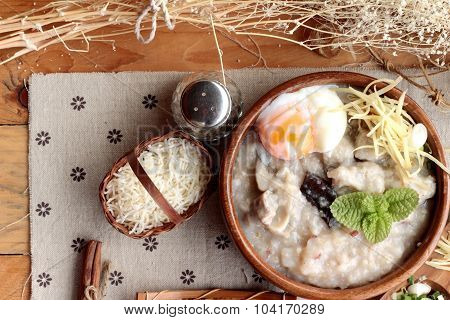Brown Rice Porridge Put Pork And Soft-boiled Egg Of Delicious.