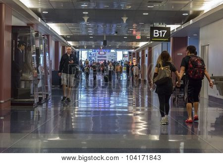 People walk along airport corridor