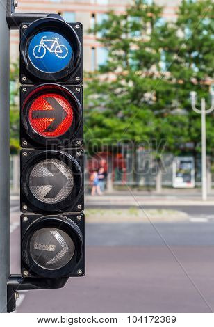 Bicycle traffic lights with red light and arrow