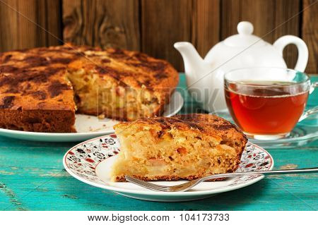 Homemade Yummy Apple Pie, Black Tea And White Teapot On Turquoise Table