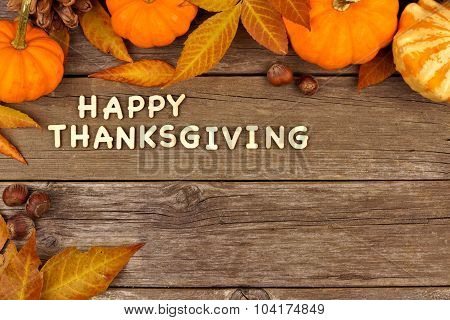 Happy Thanksgiving wooden letters with autumn corner border on wood