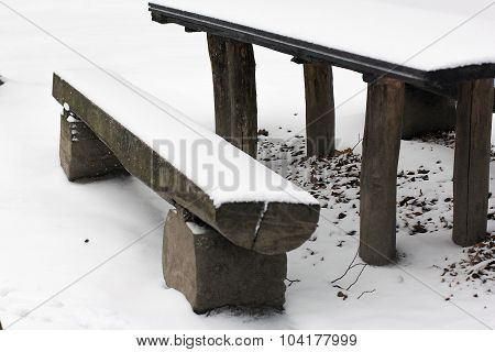 Wooden Bench And Table Covered With Snow