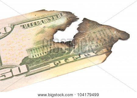 Burnt Dollar Banknotes On White