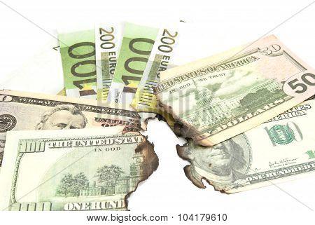 Burnt Bills Of Euro And Dollar Closeup