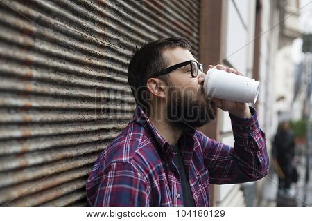 Man With Beard And Glasses Drinking Coffee Tea To Go