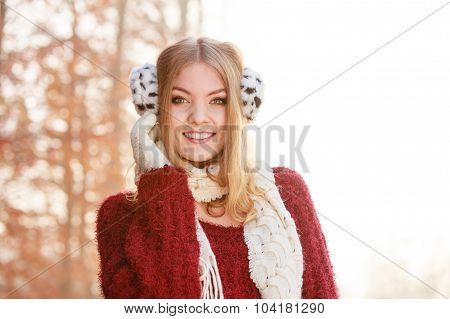 Portrait Of Pretty Smiling Woman In Earmuffs.