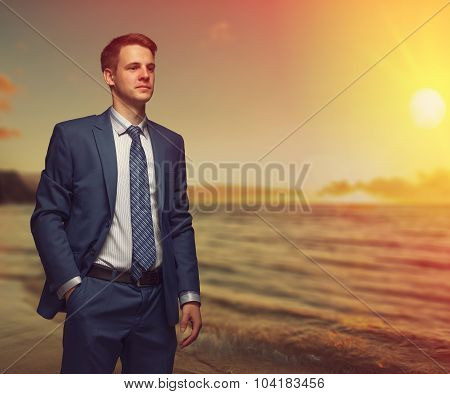 Office Worker On The Beach During Sunset.