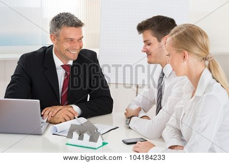 Couple Consulting Estate Agent
