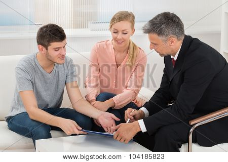 Consultant Showing Project Investment To Couple