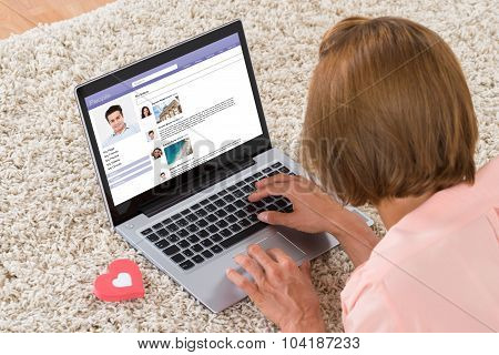 Woman With Heart Sign Chatting On Social Networking Site