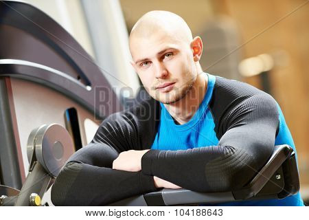 Portrait of a male fitness bodybuilder trainer coach standing in the gym