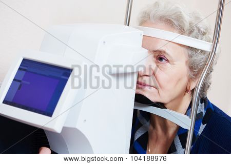 Adult optometry. Senior woman patient under eyesight examination in eye ophthalmological clinic
