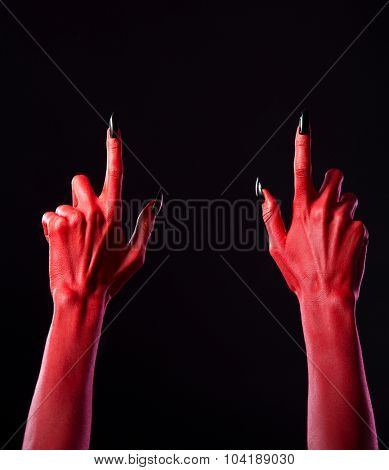 Red devil hands pointing fingers up, Halloween theme