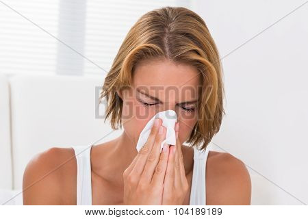 Woman Blowing Nose In Tissue Paper